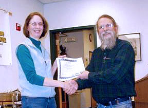 Joyce Bateman receives award during AIM-COMM Bullseye Pistol League